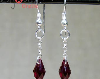 Earrings in silver and Red swarovski drops