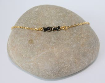 Black gold beads and gold bracelet