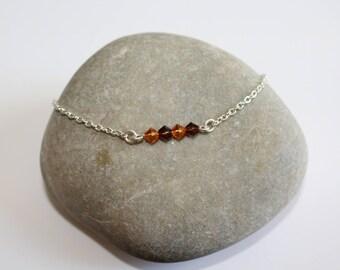 Bracelet in silver metal beads and Swarovski bicones ochre/Brown