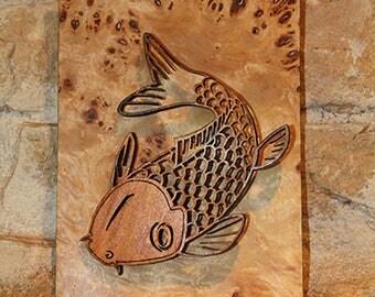 Decorative painting of a koi fish wood cut