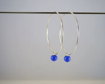 Silver hoop earrings 925 (5cm) decorated with blue glass Lampwork bead. Made by Rosa Rueda