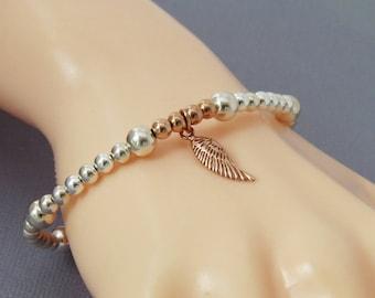 Rose Gold Angel Wing Bracelet, Silver Angel Wing Bracelet, Stretch Bead Stacking Bracelet, Layering Bracelet, Silver Rose Gold Jewellery
