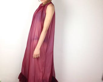 Long sheer dreas with ruffles and gold neck