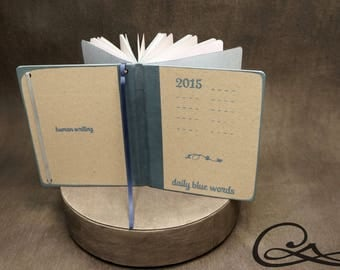 Book 17 x 22 cm decorated with printing ink