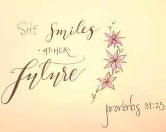 """Calligraphed biblical quote, """"She smiles at her future."""""""