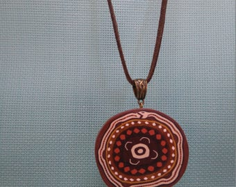 §73§ pendant snake polymer mounted on brown suede cord and bail