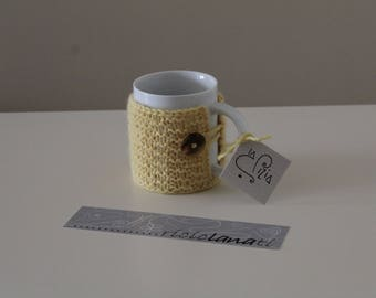 Cup with knitted wool made toilet seats