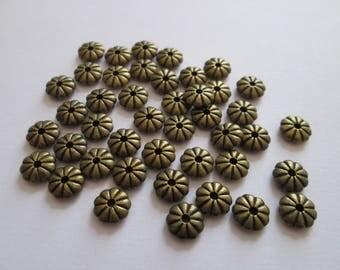 30 perles palet fleur en métal bronze 7 mm