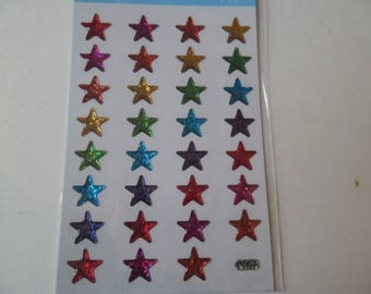 31 domed stickers stickers in the shape of stars of different glitter colors