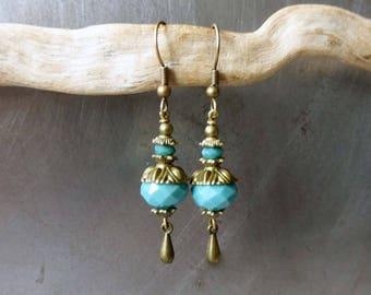 "Earrings ""etourdies"" blue glass faceted beads."