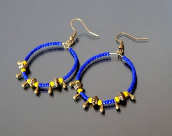 Hoop earrings yellow and blue glass beads.