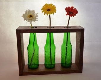 Wooden vase and bottles