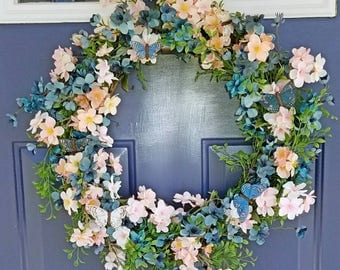 Spring Summer wreath with blue and pink flowers and butterflies. High quality wreath. Flower wreath UV protected butterfly wreath