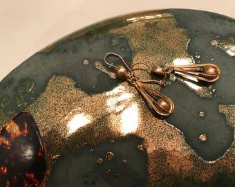 Artsy 14k yellow gold drop earrings .