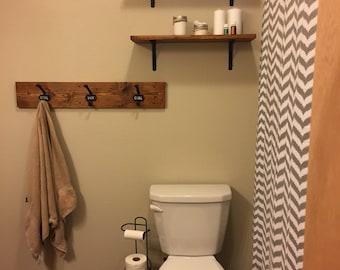 Bathroom towel rack and robe hanger