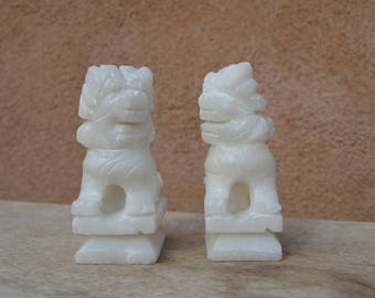 "Vintage Chinese pair of white soapstone carved Foo dogs, facing each other.  4"" tall, 2"" deep, and 1.25"" wide"