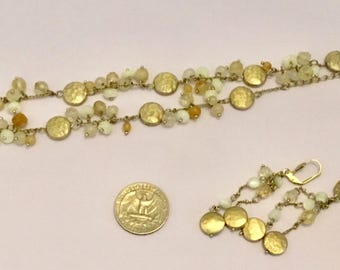 Gold colored beaded necklace and matching earrings