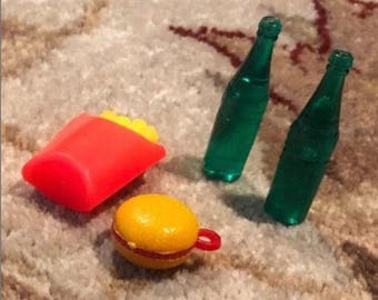 Miniature toys- hamburger, french fries, and 2 soda bottle.