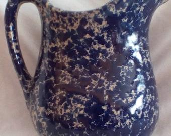 blue and white speckle glazed ceramic pitcher