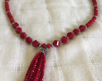 Red opaque crystal necklace with crystal tassel.