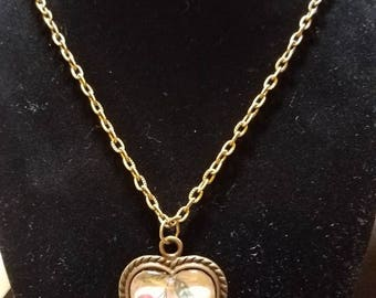 Homemade necklace. Antique bronze setting. Cherries depicted