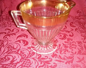 Vintage. Clear glass creamer trimmed in gold.