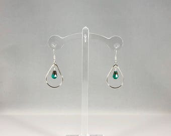Metal tear drop earrings with unique bead accent