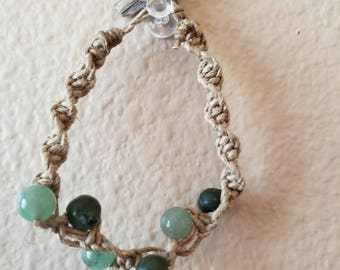 Green serpentine and twisted hemp bracelet with petrified wood closure.