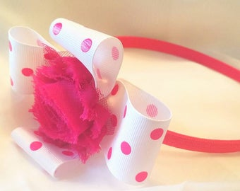 Handmade polka dot  pink and white bow topped with shabby flower on pink headband
