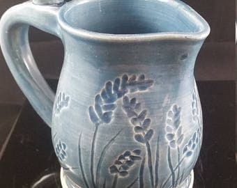 Blue celadon carved pitcher