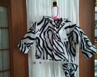 Hooded fleece jacket 6 to 12 month in zebra print with pink snap front. Matching thumbless mittens. Items lined.