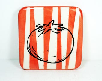 tile with a red-orange background and a Tomato print, ready to ship