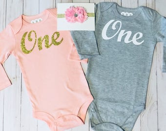 "First birthday onesie -- ""ONE"" in cursive pink or grey long sleeve onesie .... order one or both--- perfect for party wear."