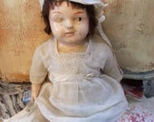 Reserved for Ness: adorable antique doll, very old, small and petite, very cute with antique dress and bonnet