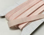 "9.3 m / 10.1 yds — satinized foldover lingerie elastic / edge binding, light pink / rosewood /rosy beige — 16 mm / 5/8"" wide"