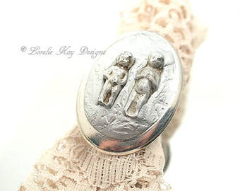 A Study in Frozen Charlottes Doll Ring Cast Metal Doll Ring One of a Kind Wearable Mixed Media Art