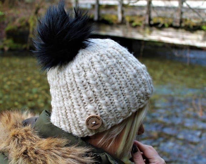 Merino wool knit hat. Faux fur pom pom.  Warm. Soft. Cozy. Handspun merino yarn.