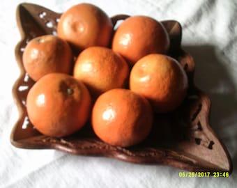 Seven Artificial Oranges