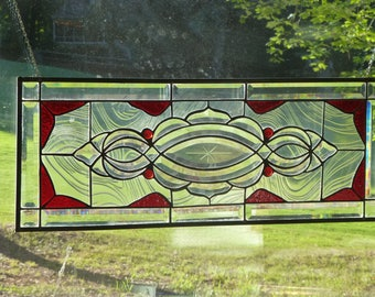 Red and clear beveled stained glass transom
