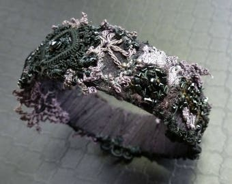 Nightshade ~ shabby patchwork bangle bracelet ~ dusty purples and black vintage laces ~ hand stitched beaded textile collage