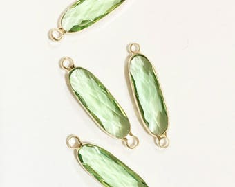 4 pcs Glass faceted oval with  brass setting 27x7mm , light green , glass connector 1/1 loop with  brass setting, long oval connector