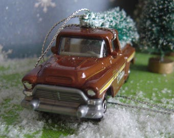1957 GMC Stepside Sheriff Truck with Christmas tree ornament