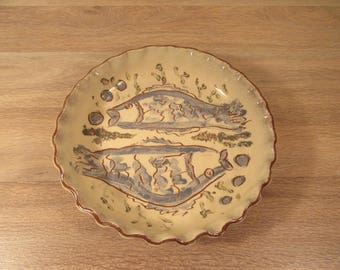 Glazed stoneware pottery pie plate or baking dish with fluted edges and interior fish design