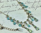vintage 1928 brand dangle necklace silver toned with aquamarine and peridot beads and drops 16 to 18 inch