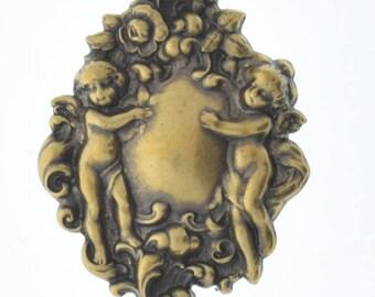 Brass stamping Cherubs  , victorian motif ,  sold by each 04226AG
