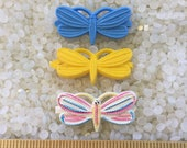 vintage  barrette plastic childs barrettes, set of 3 butterflies  , brigtht blue, yellow, and rainbow butterfly