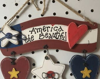 """America the Beautiful hanging wood sign. Handmade Hand painted, 6"""" long x 8"""" wide"""