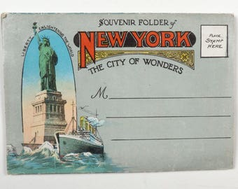 A New York souvenir folder The City of Wonder, this 1930s postcard has 30 colour images of famous buildings and architecture and is unmailed