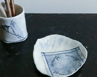 HANDWORK - Handmade ceramic ring dish in blue and white with impression of a vintage handstitched textile.  Porcelain home decor.