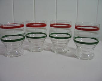 Set of four swanky swigs, juice glasses with red, white, and green stripes